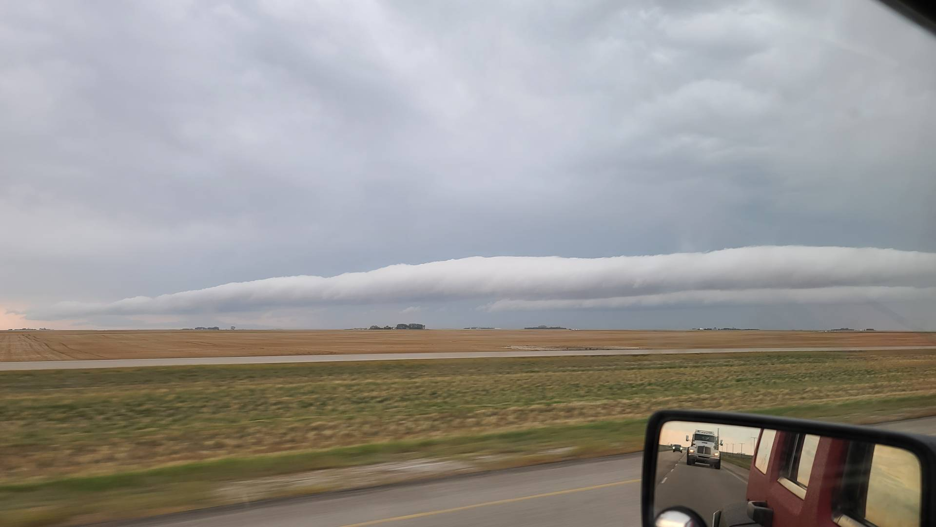 Big roll cloud pushing out ahead of Dying thunderstorm south of Regina, SK 10:40am #skstorm